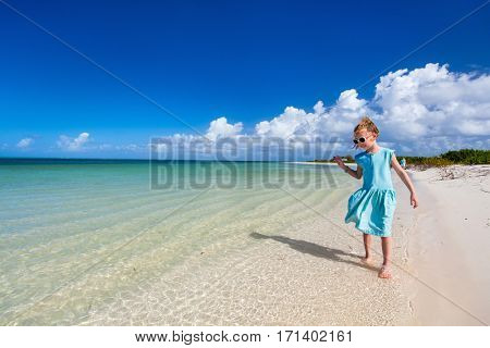 Mother and daughter family on tropical beach during summer vacation