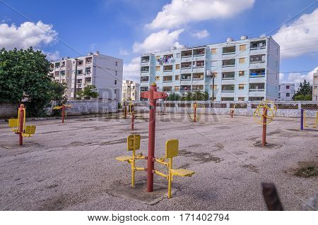 The real Cuba: Emty playground and apartment blocks in residential area in Trinidad, Cuba