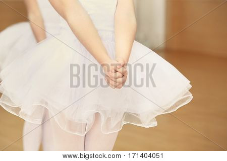 Little girl practicing ballet at class, closeup