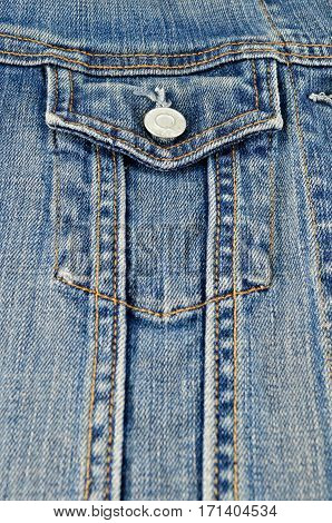 Closeup blue jeans shirt pocket cloth texture