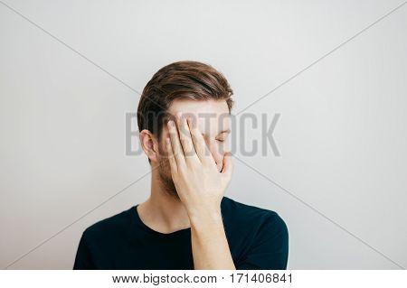 Portrait of a attractive caucasian man hiding his face