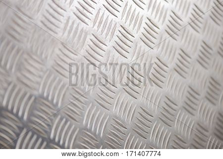 Shiny steel or alloy tread plate for backgrounds