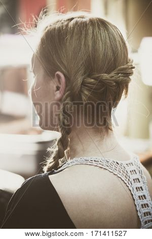 woman portrait with modern style braid in hair at hair studio