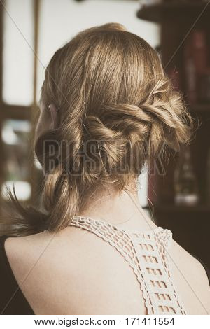 modern loose  braided woman hair closeup back view