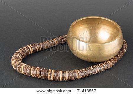 Golden Tibetian singing bowl and wooden beads