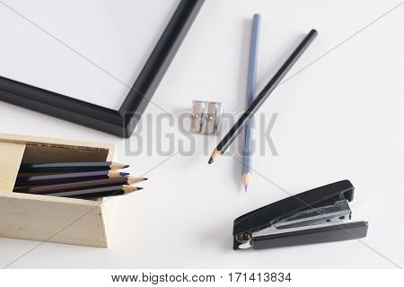 Office stationery. Pencil box stapler and pencil sharpener on white background