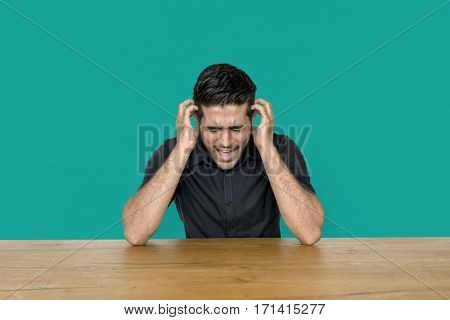 Stress man is sitting at wooden table