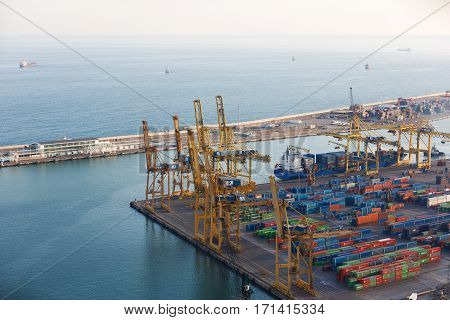 Barcelona Spain - January 07 2017: Cranes and containers at the port of Barcelona view from Montjuic hill