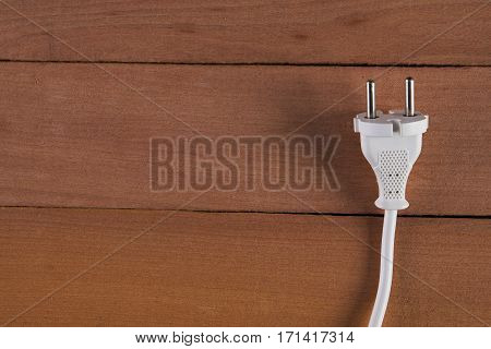 Energy Electricity Electric Plug on wooden background