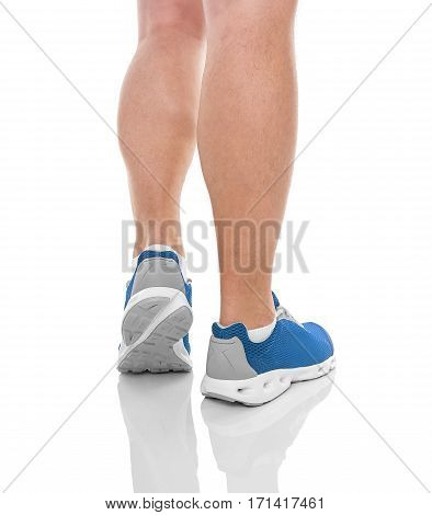 Men's sports legs in sneakers isolated on white background. Back view.