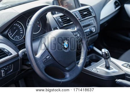 VARNA BULGARIA - MARCH 17 2016: The Interior of BMW Steering Wheel. BMW is a German automobile motorcycle and engine manufacturing company founded in 1916.