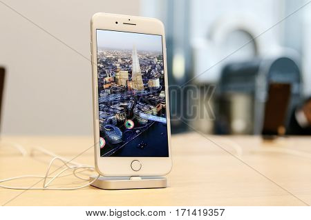 New York February 9 2017: A brand new iPhone 7 Plus stands on display on a table in Apple store on 5th Avenue.