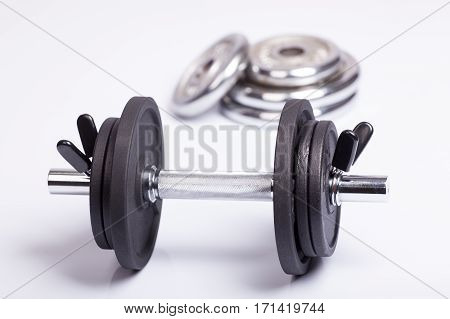 Dumbbell and barbell discs for workout. Fitness