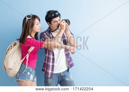 young couple go to travel and take picture