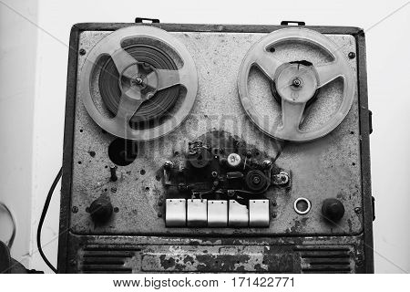 Black and white art photography monochrome Old retro film recorder. Musical instrument on a gray background.