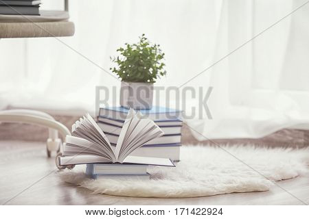 Pile of books on the floor at home