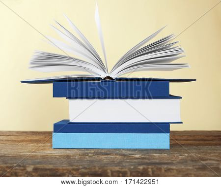 Stack of books on yellow background