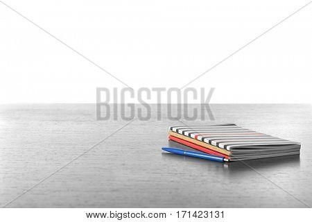 Copybooks on wooden desk