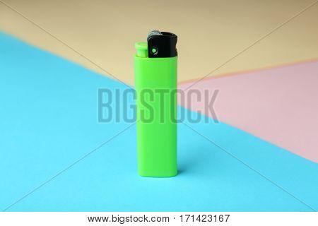 Blank cigarette lighter on color paper background