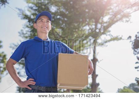 delivery man stand and look somewhere asian