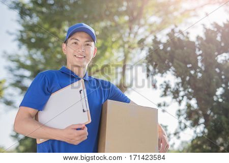 deliveryman take cardboard and smile to you asian