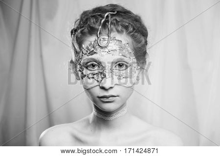 Black and white art photography monochrome hairstyle in the Greek style. Vogue style portrait of a girl with a white bodyart on her face. Body painting project. Woman painted white colors. Makeup