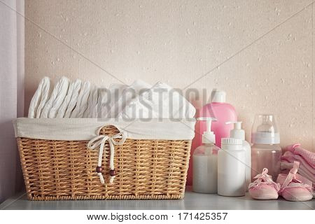 Baby necessities on white chest of drawers