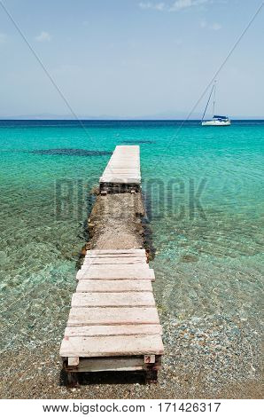 Boat and pier on the Aegean island of Samos