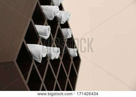 Shelf with towels in hairdressing salon