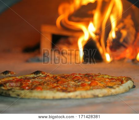 Neapolitan pizza  in front of the fire
