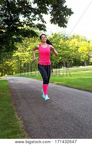 a young woman training in the park