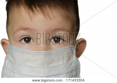 Little boy in medicine healthcare mask on a white background