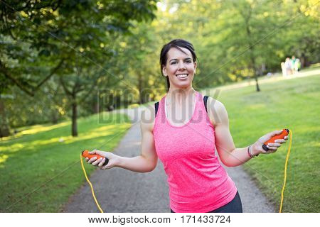 a young woman using a skipping rope