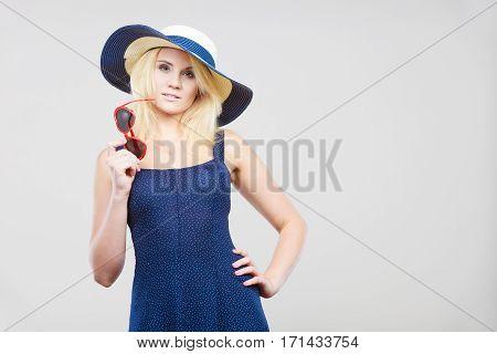 Woman Wearing Short Navy Dress And Sun Hat
