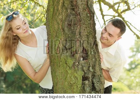 Love romantic walks concept. Man and blonde woman having romantic date in park happy being together.