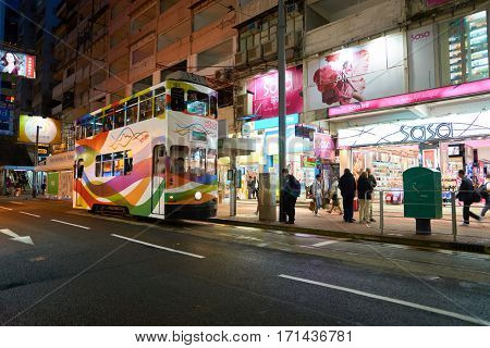 HONG KONG - CIRCA NOVEMBER, 2016: a double decker train in Hong Kong urban landscape at nighttime. Hong Kong  is an autonomous territory on the Pearl River Delta of East Asia.