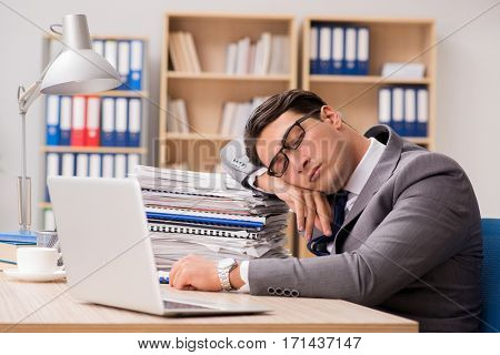 Businessman tired sitting in the office