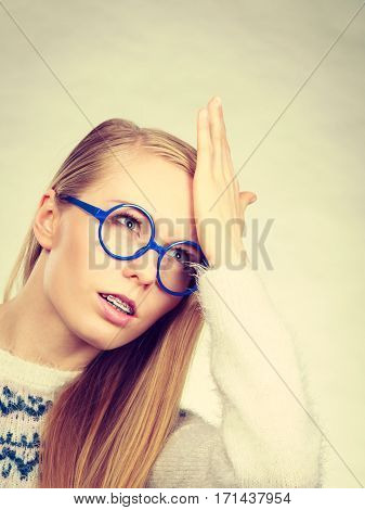 Nerd Blonde Woman Holding Hand On Forehead
