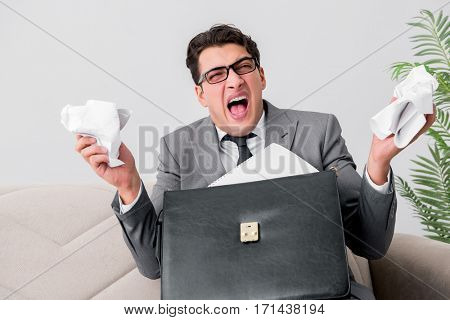 Angry businessman with crumbled paper