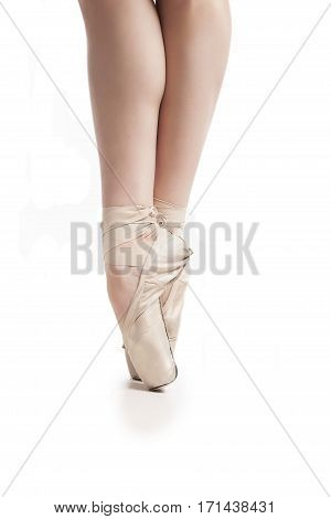 legs in pointe ballerina isolated on white background