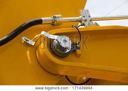 Chrome- plated hydraulic mechanism close- up shot