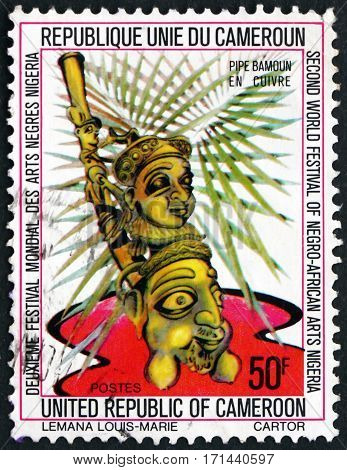 CAMEROON - CIRCA 1977: a stamp printed in Cameroon shows Bamoun copper pipe 2nd world black and African festival Lagos Nigeria circa 1977