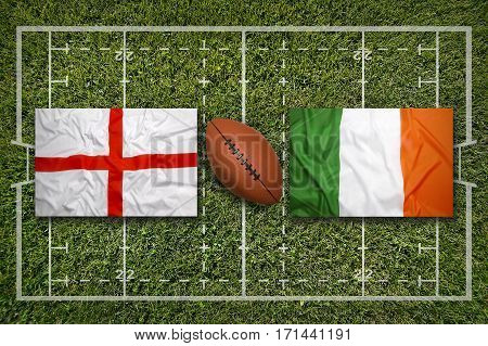 England vs. Ireland flags on green rugby field, 3 D illustration