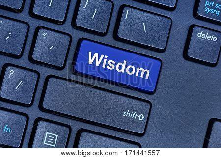 Wisdom word on computer keyboard button closeup