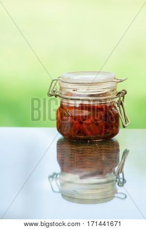 Homemade Sun dried tomatoes with olive oil in a jar