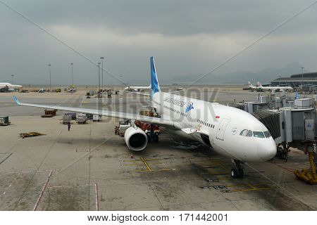 HONG KONG - NOV. 9, 2015: Garuda Indonesia Airbus 330-200 at the gate in Hong Kong International Airport (Chek Lap Kok Airport).