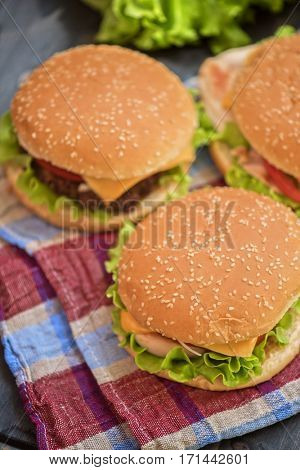 Closeup of home made burgers on wooden table