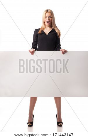 Surprised businesswoman holding placard. Isolated on white