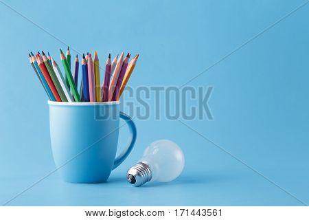 Art Creative Idea Concept, Pencils In Mug And Light Bulb