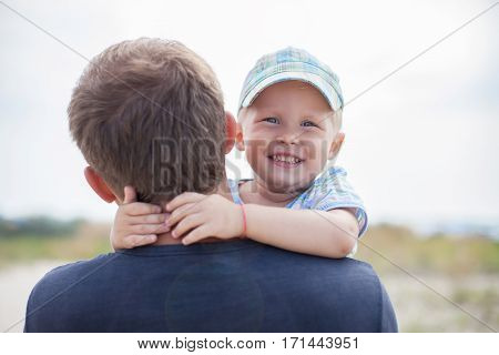Boy On His Father's Hands, Hugs, Smiles, Laughs,